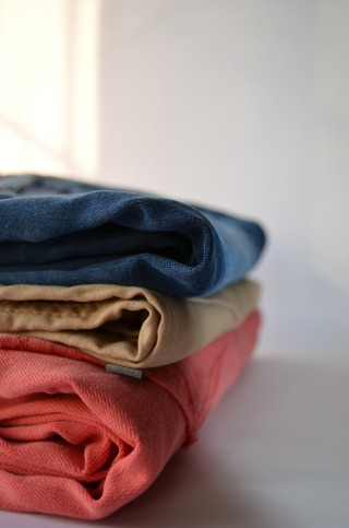 A pile of folded trousers
