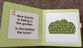 Page of Sophie the giraffe book - green background with a bush and asking if Sophie is hiding behind the bush