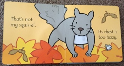 Page of that's not my squirrel book with a grey squirrel over some leaves with a white chest made of fuzzy material